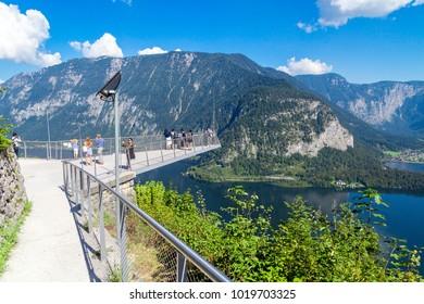 HALLSTATT, AUSTRIA - SEPTEMBER 14, 2016 : The World Heritage Viewing Platform Skywalk has spectacular high view of Hallstatt Lake (Hallstatter See) among Alp mountains UNESCO Heritage Site in Austria.