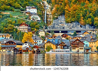 Hallstatt austrian alps resort and mountain village with traditional rural alps houses, restaurants, hotels and wooden boat houses at Hallstatt lake. Location: Hallstatt lake, Austria, Alps.