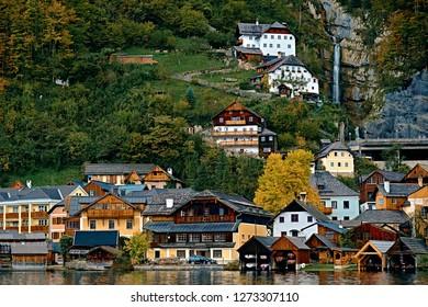 Hallstatt austrian alps resort and mountain village with traditional rural alps houses, restaurants, hotels and wooden boat houses at Hallstatt lake. Location: Hallstatt lake, Austria, Alps.