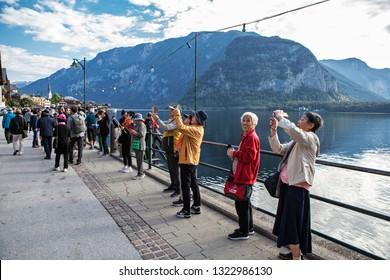 HALLSTATT, AUSTRIA-SEP 11, 2018: Korean tourists in Hallstatt.