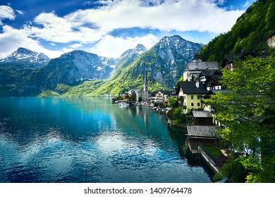 Hallstatt with beautiful view of mountain, lake and village in springtime, Salzkammergut region, Austria