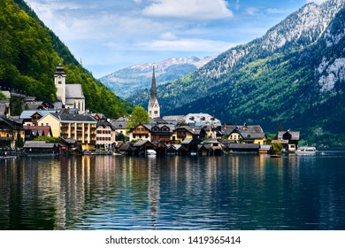 Hallstatt with beautiful view of mountain, lake and village in springtime, Salzkammergut region, Austria