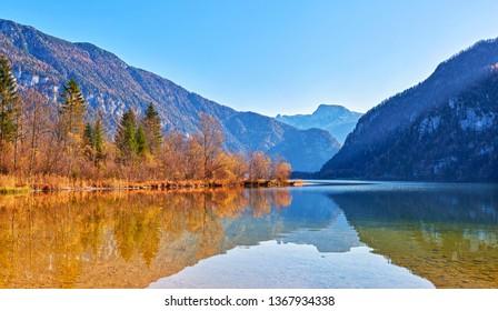 Hallstatt lake at sunny, blue sky and mountain Sarstein. Late autumn, Salzkammergut region, Austria.