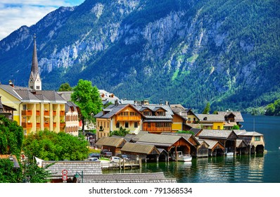 Hallstatt in mountains Alps Austria. Scenic landscape with view on lake. Ancient european town green trees.