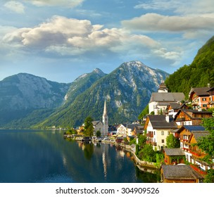 Hallstatt  village and alpine lake in morning lights. Austrian Alps