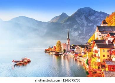 Hallstatt village on Hallstatter See Lake in High Alps Mountains. Picturesque landscape of Great Alpine nature. Hallstatt is famous romantic European UNESCO travel destination.
