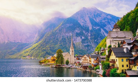 Hallstatt village on Hallstatter See Lake in High Alps Mountains, Upper Austria. Picturesque landscape of Great Alpine nature. Hallstatt is famous romantic place European travel lakeside destination