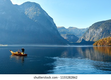 Hallstattersee near Obertraun. Two people are in the boat. Beautiful sunrise. Salzkammergut region, Austria.