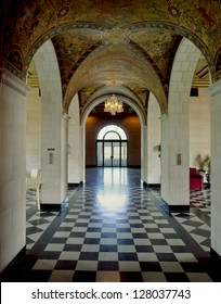 A hallway and a checkered terrazzo floor in the Marland Mansion in Ponca City, Oklahoma, USA. The mansion is an Italian style villa on the plains of northern Oklahoma.