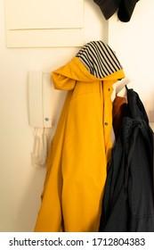 Hallway hanger yellow rain cloak wall