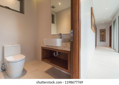 hallway  interior design  with  Luxury bathroom features basin, toilet bowl in the  home, house , building , hotel , resort