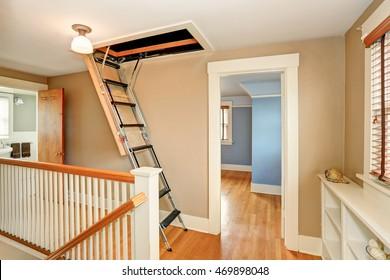 Hallway interior with folding attic ladder. Northwest, USA