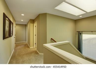 Hallway interior with green walls and carpet floor