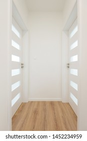 Hallway with white closed doors in apartment