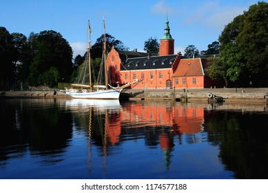 Halmstad Castle (Halmstads slott), a 17th-century castle on the Nissan river in Halmstad, in the province of Halland, Sweden with a two-master moored in front