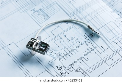 halogen lamp on the background of electric circuit