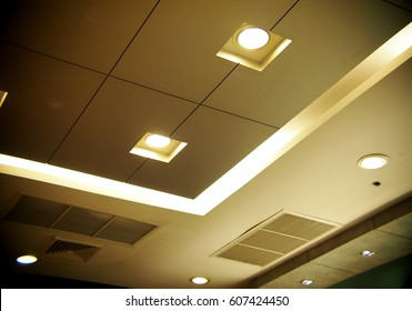 Halogen and LED bulbs ceiling lamps lighting with soft warm colour tone in a conference and studying room, selective focus for use as backdrop or background