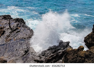Halona Blowhole is a rock formation and a blowhole on the island of Oahu, Hawaii off of Hanauma Bay at Halona Point overlooking the Pacific Ocean.