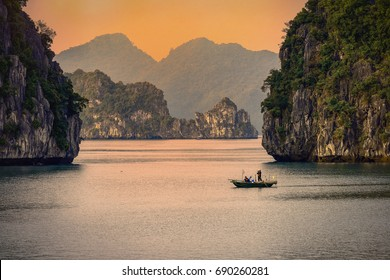 Halong bay boats,Sunset at Ha Long Bay scenic view , Hanoi, Vietnam