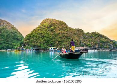 HALONG BAY, VIETNAM, April 5, 2019: Men rowing sampan with tourist in Halong bay.