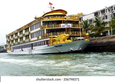 HALONG BAY, VIETNAM - FEB 2, 2015 - Yellow dragon head on prow of boat Halong Bay, Vietnam