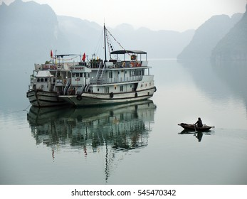 HALONG, VIETNAM - FEBRUARY 21 : Tourist Junks in Halong Bay, Vietnam on FEBRUARY 21, 2015. Ha Long Bay is a UNESCO World Heritage Site