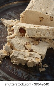 Halva with almonds, made of crushed sesame seeds and honey, sliced