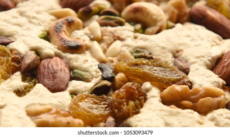 Halva, a Mediterranean sweet made from sesame seeds after being grounded into tahini, mixed with roasted nuts and raisins.