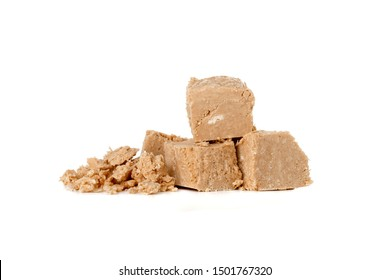 Halva on a white background. Arabian sweetness of caramel mass and ground roasted kernels of nuts, peanuts, close-up.