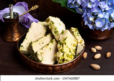 Halva with pistachio served with coffee in copper dish