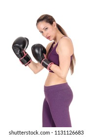 A halve body image of a woman boxing and in workout outfits standing