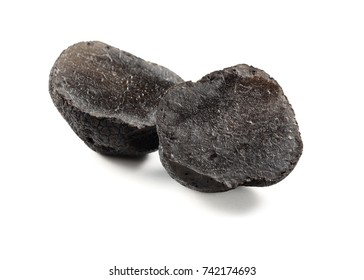 halved black truffle isolated