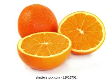 halved fresh oranges on white background