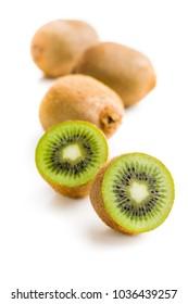 Halved kiwi fruit isolated on white background.