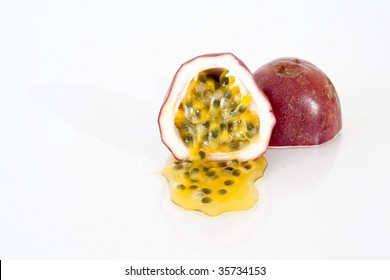 halved passion fruit on white reflective surface
