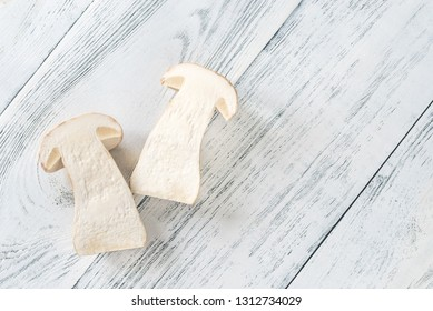 Halved porcini mushroom on the wooden background
