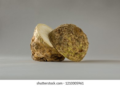 Halved Raw Celeriac on Gray Seamless Surface