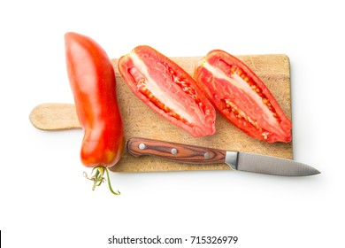 Halved San marzano tomatoes isolated on white background. Top view