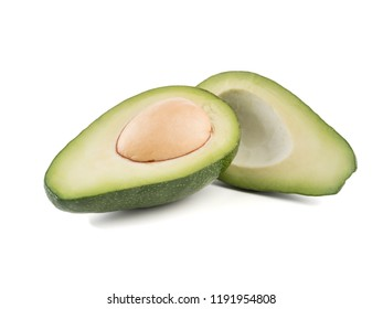 A halved sliced avocado with stone isolated on white background.