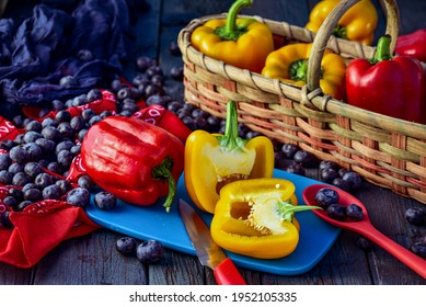halved sliced red bell peppers and yellow bell peppers on blue cutting board kitchen food preparation