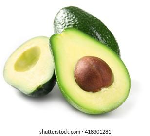 Halves of fresh avocado isolated on white