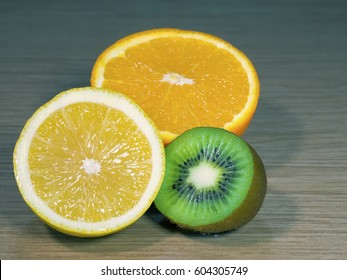 Halves of lemon, kiwi and an orange closeup