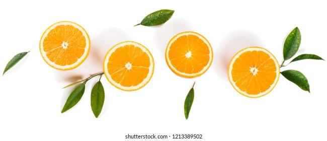 Halves of orange fruits and leaves with drops of water isolated on white background. Flat lay, top view.