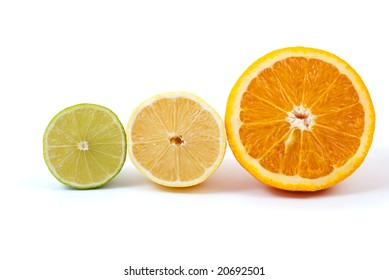 Halves of orange, lemon and lime isolated on the white background