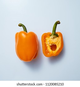 halves of yellow sweet pepper on a gray background