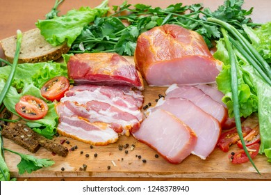 Ham and brisket with greenary, salad, onion and bread on wooden table