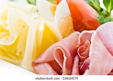 ham and cheese , macro shot , focus on a ham