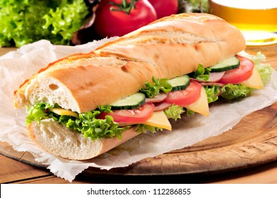 Ham and cheese salad submarine sandwich from fresh baguette.