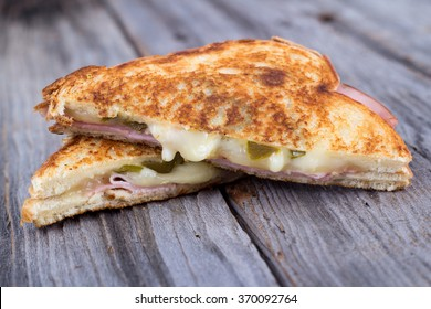 ham and cheese sandwich on rustic wooden table