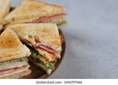 ham and cheese sandwich on a wooden plate - with space for text - copy space